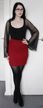 Stretch cotton top with full mesh sleeves. Red stretch knitted look pencil skirt with grey heart pattern.