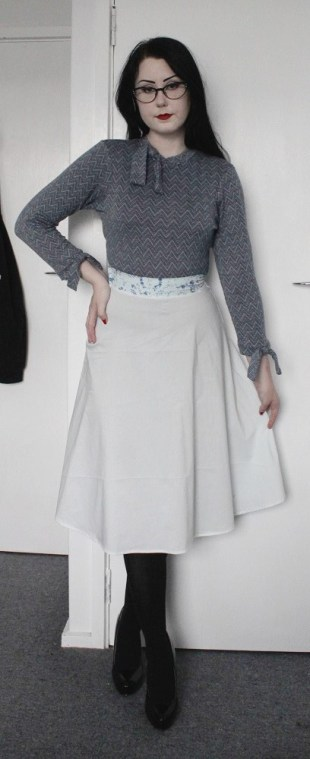 Merino chevron 3/4 sleeve top with bows. Blue cotton skirt with contrast floral waistband.