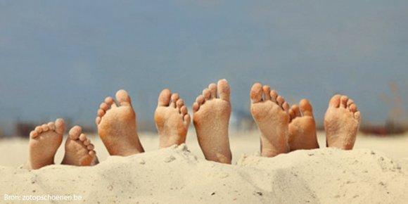 voeten in zand