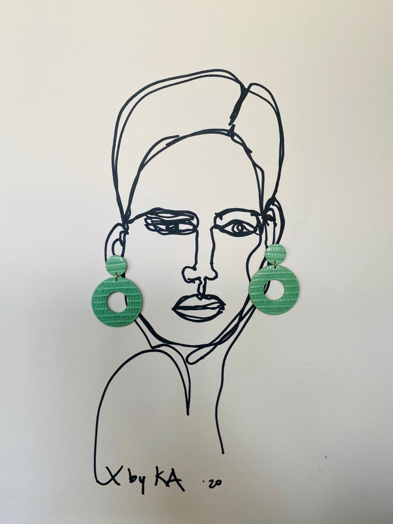 Ronde oorbellen in groen leer