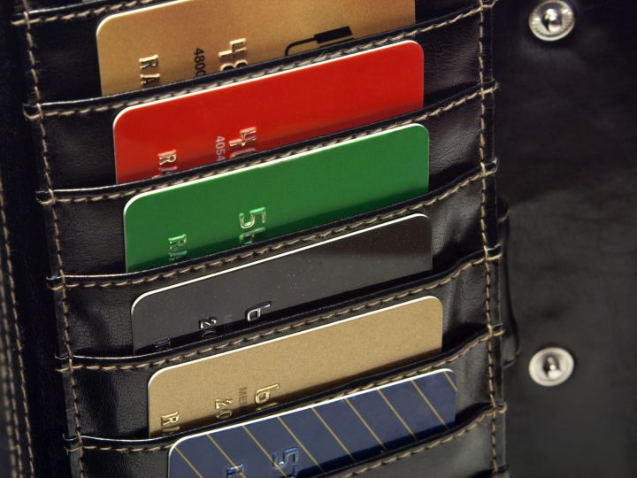 Multiple credit cards in a tall leather wallet