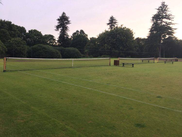 Outdoor grass tennis courts at Stoke Park