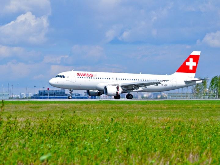 SWISS plane on runway awaiting takeoff