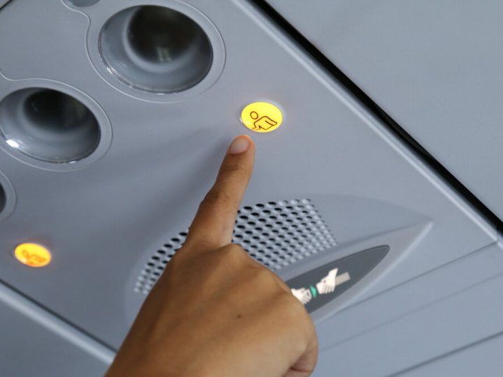 Generic flight attendant call button on airplane