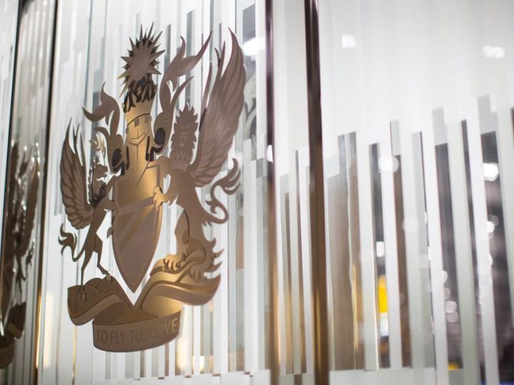 British Airways logo on glass lounge door