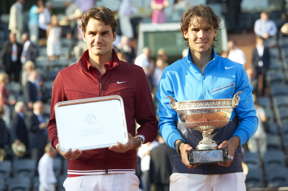 Tennis: French Open: (L-R) Switzerland Roger Federer with runner's up trophy and Spain Rafael Nadal victorious, holding Coupe des Mousquetaires trophy after Men's Final at Stade Roland Garros. Paris, France 6/5/2011 CREDIT: Heinz Kluetmeier (Photo by Heinz Kluetmeier /Sports Illustrated/Getty Images) (Set Number: X86026 TK12 R6 F422 )