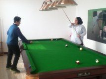 And the siblings playing pool