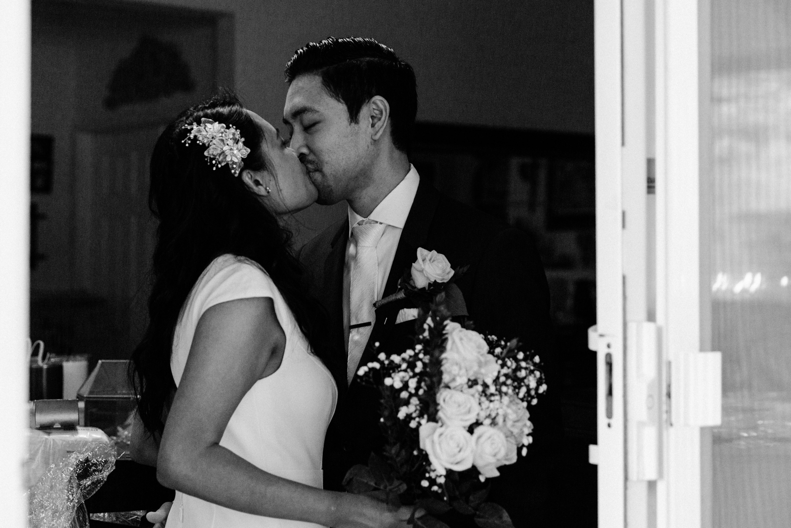 A bride and groom kissing at their micr-wedding in Southern California.