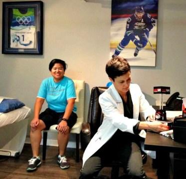 Dr. Cham prepping RockTape