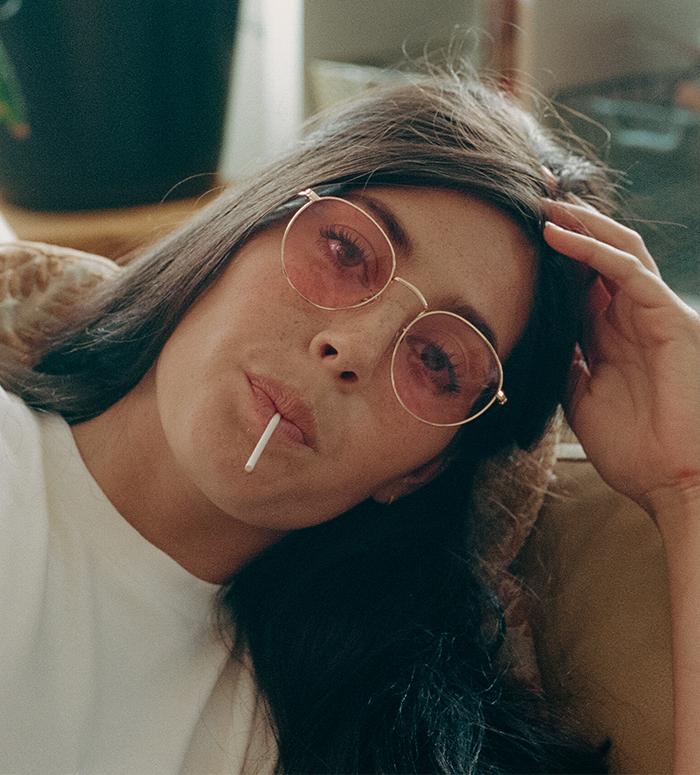 35mm film photo of model wearing pink sunglasses
