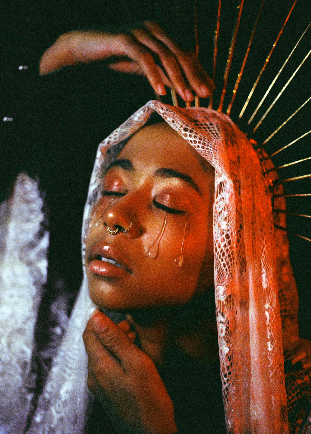 grainy film photo of girl with veil and crown