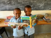 """Two boys reading books carried by """"Bertha"""""""