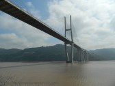 The stong liagonal leads your eye along the bridge. You get a sense of how big the bridge is.