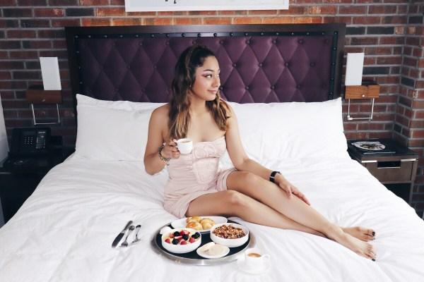 girl eating breakfast in bed