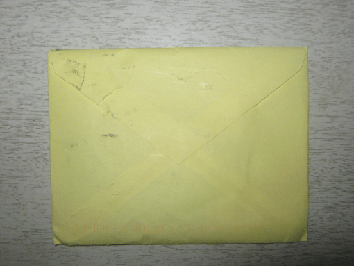 The backside of a yellow envelope.