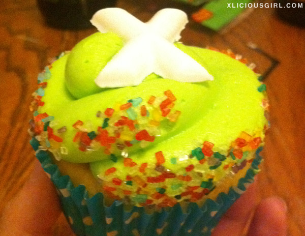 lime green cupcake with the letter X