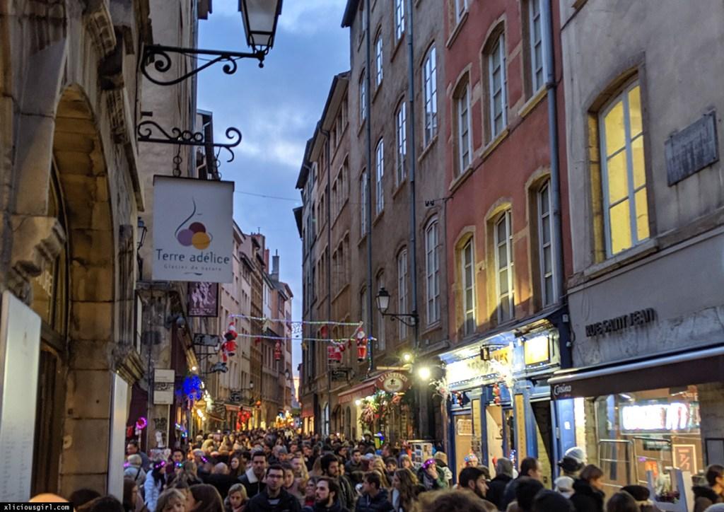 crowded narrow street in Lyon