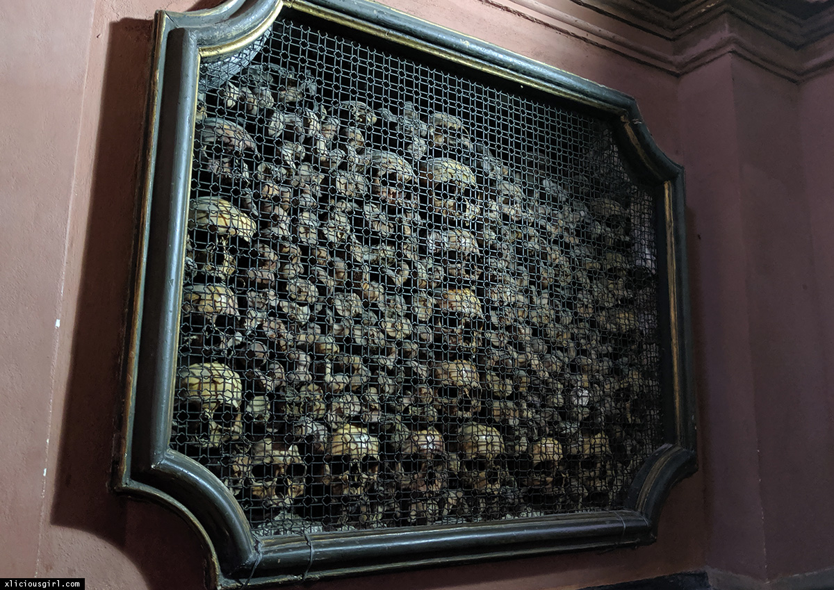 human skulls stacked within the wall