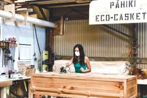 Cortney-Gusick-finish-sanding-Pāhiki's-100_-locally-reclaimed-biodegradable-and-invasive-Albizia-eco-casket