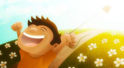 niño feliz volando cometa