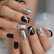 diseños de uñas negras de plata