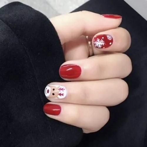 Diseño de uñas de santa claus y papá noel