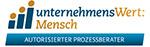 Logo unternehmensWert: Mensch Autorisierter Prozessberater