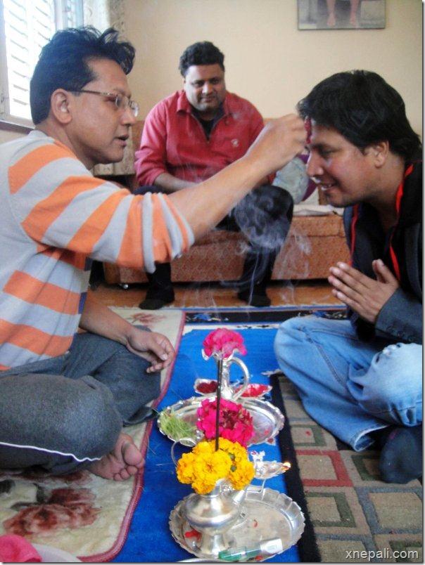 dipak_raj_giri_nirmal_sharma_receiving_dashain_tika from_dinesh_dc_2069