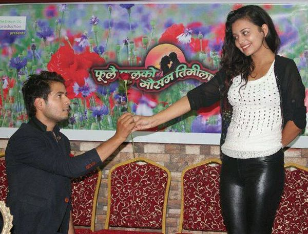 neeta dhungana and Amesh Bhandari offering red rose