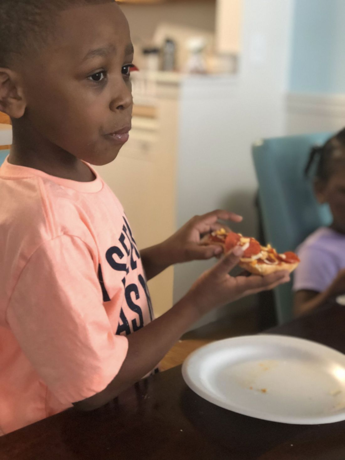 Raising children with severe food allergies; Jovani eating his homemade pizza with Daiya vegan cheese & bread slices instead of pizza dough