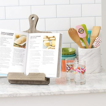 Wilton cookbook tablet holder for bakers. Holiday gift guide 2017 for the home baker. It can be so difficult to shop for a home baker and I don't know where to start. But this guide is perfect! These tools and gift ideas are amazing! I love the cute necklace to the stand mixer gifts! They all work for someone who loves to bake! Saving for later!