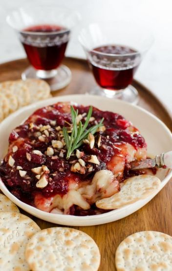 Baked Brie with Cranberry Sauce | 15 Holiday Baked Brie Recipes For Easy Entertaining #bakedbrierecipes #holidayappetizers #easybakedbrie