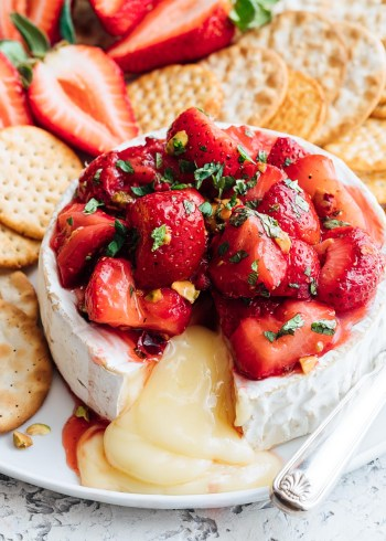 Roasted Strawberry Baked Brie | 15 Holiday Baked Brie Recipes For Easy Entertaining #bakedbrierecipes #holidayappetizers #easybakedbrie