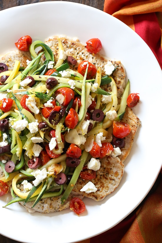 Mediterranean Boneless Pork Chops | Today we are looking at 16 clean eating dinners that'll take 30 minutes to make. It's nice to have some quick and easy clean eating recipes like these that you can refer back to. These healthy meals take 30 minutes so you can enjoy the rest of your night full and satisfied. #xokatierosario #cleaneatingdinnerrecipes #healthymeals #30minuterecipes