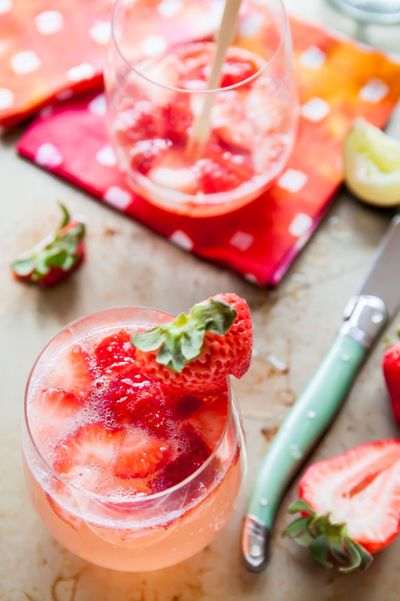 Strawberry Rose Gin Fizz | These Galentine's Day inspired cocktails are fun twists on classic cocktails that'll make your gal pal day festive! Choose from strawberry Moscow mules or homemade Frosé, cotton candy champagne or a pink senorita. These Galentine's day cocktails will elevate your next girls night! #xokatierosario #galentinesdaydrinks #girlsnightideas #girlsnightcocktails