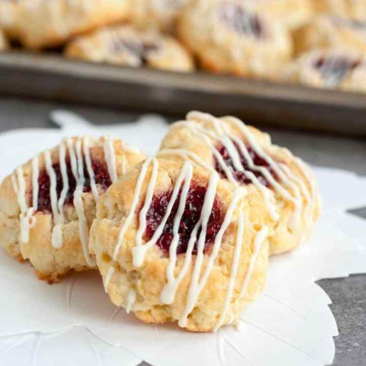 Jammy Thumbprint Scone Bites | Scones are little nuggets of golden brown goodness known for accompanying your afternoon tea. You can choose different flavor combinations like Dark Chocolate Cherry, Gruyere & Procuitto, and Maple Bacon. Here are some basic tips before baking scones to guarantee you get perfect scones every time. How to Make Sweet & Savory Scones Perfect Every Time! #xokatierosario #easysconerecipes #homemadescones #sweetscones