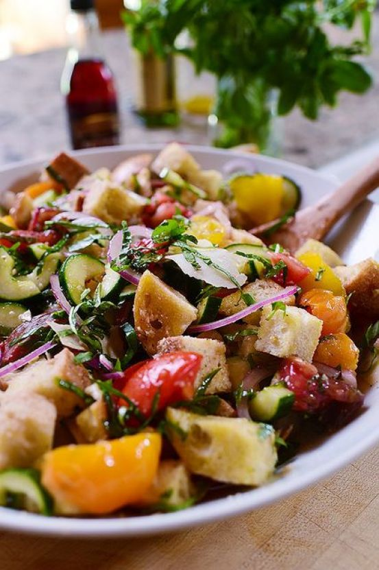 Panzanella Salad | These spring garden party recipes are light and refreshing and perfect for any outdoor entertaining. With the warmth of spring and all the flowers blooming throwing a garden party is the best way to embrace the new season. These simple garden party recipes are something anyone can make and impress your guests. #xokatierosario #springdinnerideas #gardenpartyfood #easypartyrecipes