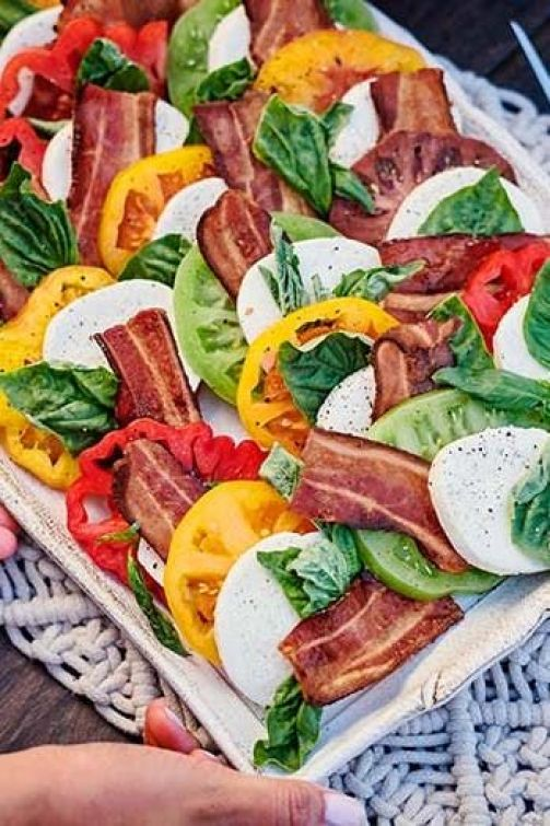 Bacon Heirloom Tomato Caprese Salad | These spring garden party recipes are light and refreshing and perfect for any outdoor entertaining. With the warmth of spring and all the flowers blooming throwing a garden party is the best way to embrace the new season. These simple garden party recipes are something anyone can make and impress your guests. #xokatierosario #springdinnerideas #gardenpartyfood #easypartyrecipes
