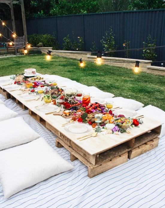 DIY Pallet Picnic Table | The perfect way to welcome the spring is to host a Garden Party. If DIY is your middle name, then you will love these garden party ideas. These garden party ideas are simple and easy to make but will have a significant impact on your garden party. There's no better way to celebrate spring than with a fun and festive DIY garden party. #xokatierosario #DIYgardenpartyideas #easygardenpartyideas #vintagegardenparty
