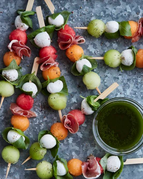 Melon Caprese Skewers | These spring garden party recipes are light and refreshing and perfect for any outdoor entertaining. With the warmth of spring and all the flowers blooming throwing a garden party is the best way to embrace the new season. These simple garden party recipes are something anyone can make and impress your guests. #xokatierosario #springdinnerideas #gardenpartyfood #easypartyrecipes