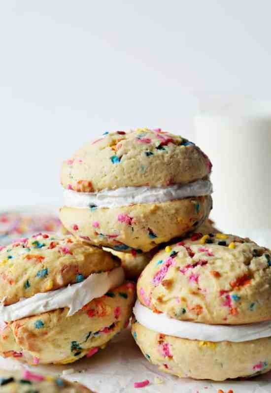 Whoopie Birthday Cake Pies | Do you wish that every day can be your birthday? Making funfetti birthday cake is like celebrating your birthday anytime you want. Funfetti birthday cake is a moist vanilla cake that is studded with rainbow sprinkles, so it looks like confetti. You can choose from cinnamon rolls, biscotti, whoopie pies, and even white hot chocolate! #xokatierosario #funfettibirthdaycake #birthdaycakedesserts #funfetticakedesserts