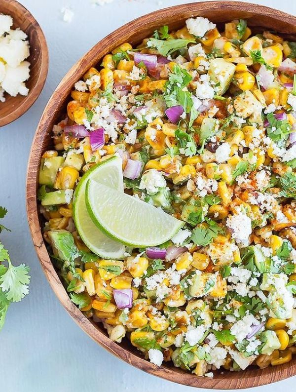 Mexican Street Corn Salad | Cinco de Mayo is fast approaching, and these easy appetizers are totally perfect for the Spring Holiday! You can choose from Mexican street corn salad, scallop ceviche, white queso dip, and even churros served with a warm chocolate espresso dipping sauce. No matter what you decide to make, you'll love any of these easy Cinco de Mayo appetizers! #xokatierosario #cincodemayo #easyappetizers #cincodemayorecipes