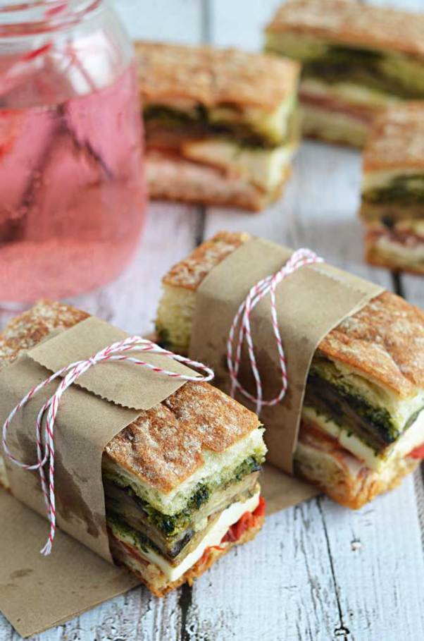 Eggplant Proscuitto Pesto Pressed Sandwich | Looking for quick and refreshing picnic recipes? You must try these picnic recipes that are perfect for making ahead of time and eating outdoors. With these summer picnic recipes, all the work is done ahead of time, prepare these delicious recipes at home before storing them in a cooler to take with you. #xokatierosario #picnicrecipes #picnicfoodideas #outdoorentertaining