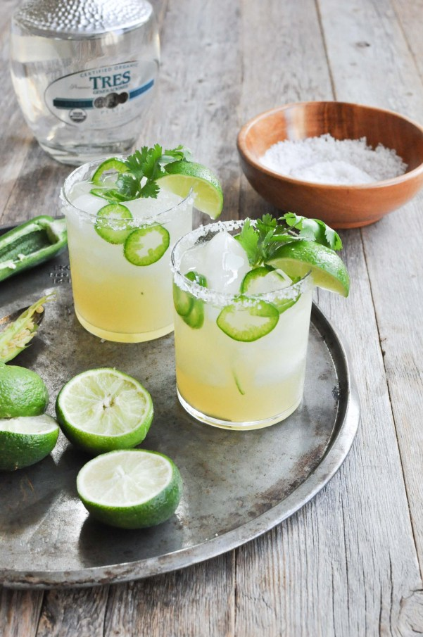 Lime & Jalapeno Margaritas | What I love most about these margarita recipes is how easily you can make these drinks ahead of time and in large batches. It's really cool how you can take simple ingredients like tequila, fruit juice, and salt and make a ton of delicious flavors. You can choose from bold and flavorful margaritas like coconut grapefruit, blackberry thyme, strawberry basil, and fresh lime & jalapeno. #xokatierosario #cincodemayo #margaritarecipes #easymargaritas