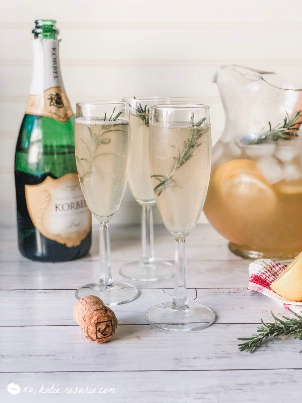 Rosemary Vanilla Lemonade Mimosas | These sparkling drinks are fantastic for summer entertaining. Whatever sparkling drinks you choose to make this summer, your thirst will be quenched, and you'll stay relaxed and happy in the summer heat. Here are 14 Sparkling Drinks That'll Keep You So Refreshed! #xokatierosario #sparklingdrinks #sparklingcocktails #sparklingnonalcoholicdrinks #summerentertaining