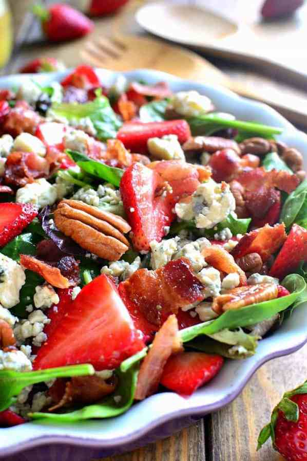 Strawberry Blue Cheese Salad | Looking for quick and refreshing picnic recipes? You must try these picnic recipes that are perfect for making ahead of time and eating outdoors. With these summer picnic recipes, all the work is done ahead of time, prepare these delicious recipes at home before storing them in a cooler to take with you. #xokatierosario #picnicrecipes #picnicfoodideas #outdoorentertaining