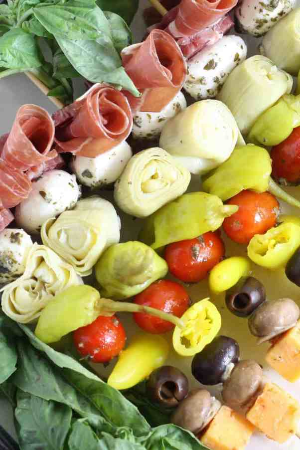 Antipasto Skewers | Looking for quick and refreshing picnic recipes? You must try these picnic recipes that are perfect for making ahead of time and eating outdoors. With these summer picnic recipes, all the work is done ahead of time, prepare these delicious recipes at home before storing them in a cooler to take with you. #xokatierosario #picnicrecipes #picnicfoodideas #outdoorentertaining