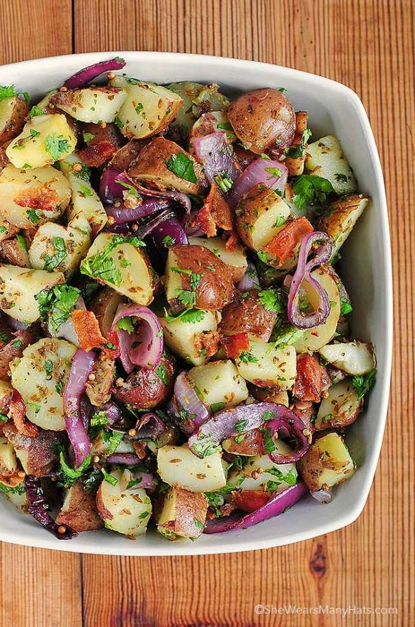 Texas Style Potato Salad | Looking for quick and refreshing picnic recipes? You must try these picnic recipes that are perfect for making ahead of time and eating outdoors. With these summer picnic recipes, all the work is done ahead of time, prepare these delicious recipes at home before storing them in a cooler to take with you. #xokatierosario #picnicrecipes #picnicfoodideas #outdoorentertaining