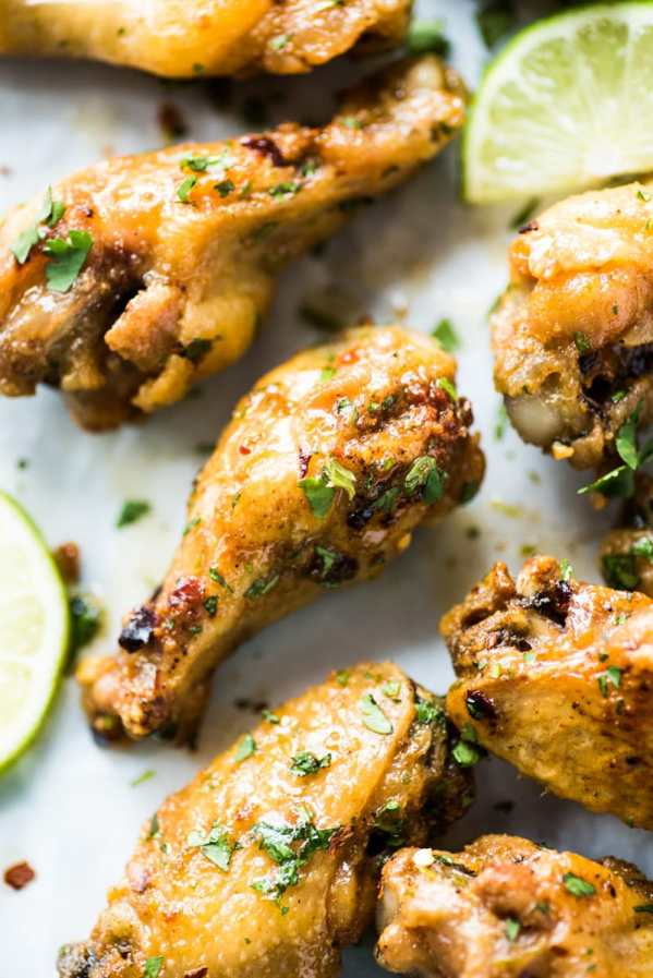 Honey Lime Baked Chicken Wings | Cinco de Mayo is fast approaching, and these easy appetizers are totally perfect for the Spring Holiday! You can choose from Mexican street corn salad, scallop ceviche, white queso dip, and even churros served with a warm chocolate espresso dipping sauce. No matter what you decide to make, you'll love any of these easy Cinco de Mayo appetizers! #xokatierosario #cincodemayo #easyappetizers #cincodemayorecipes