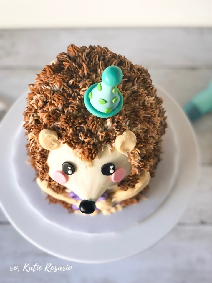 Learn how to make this adorable Hedgehog birthday cake with easy actionable steps! I'll show you exactly how to make this Hedgehog birthday cake at home. I'll teach you basic cake decorating techniques that will help you become a better decorator. It'll also help you feel more comfortable knowing that you can pull off a cute cake like this Hedgehog cake tutorial. #xokatierosario #cakedecoratingtipsandtricks #hedgehogcake #hedgehogbirthdaycake